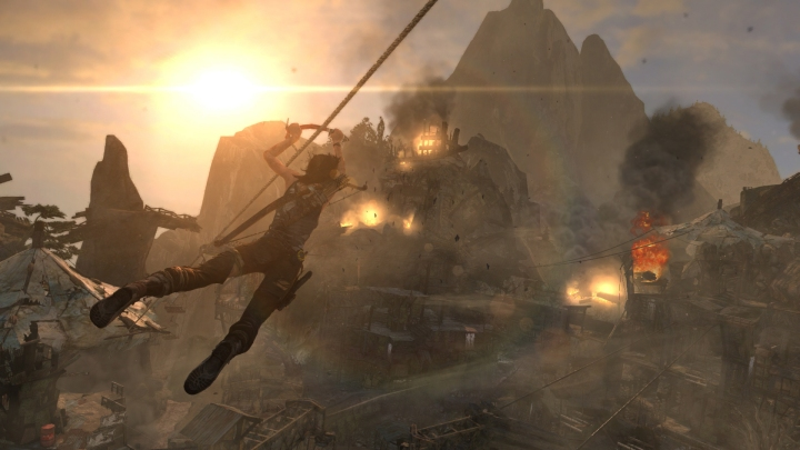 Lara slides through a shanty town.